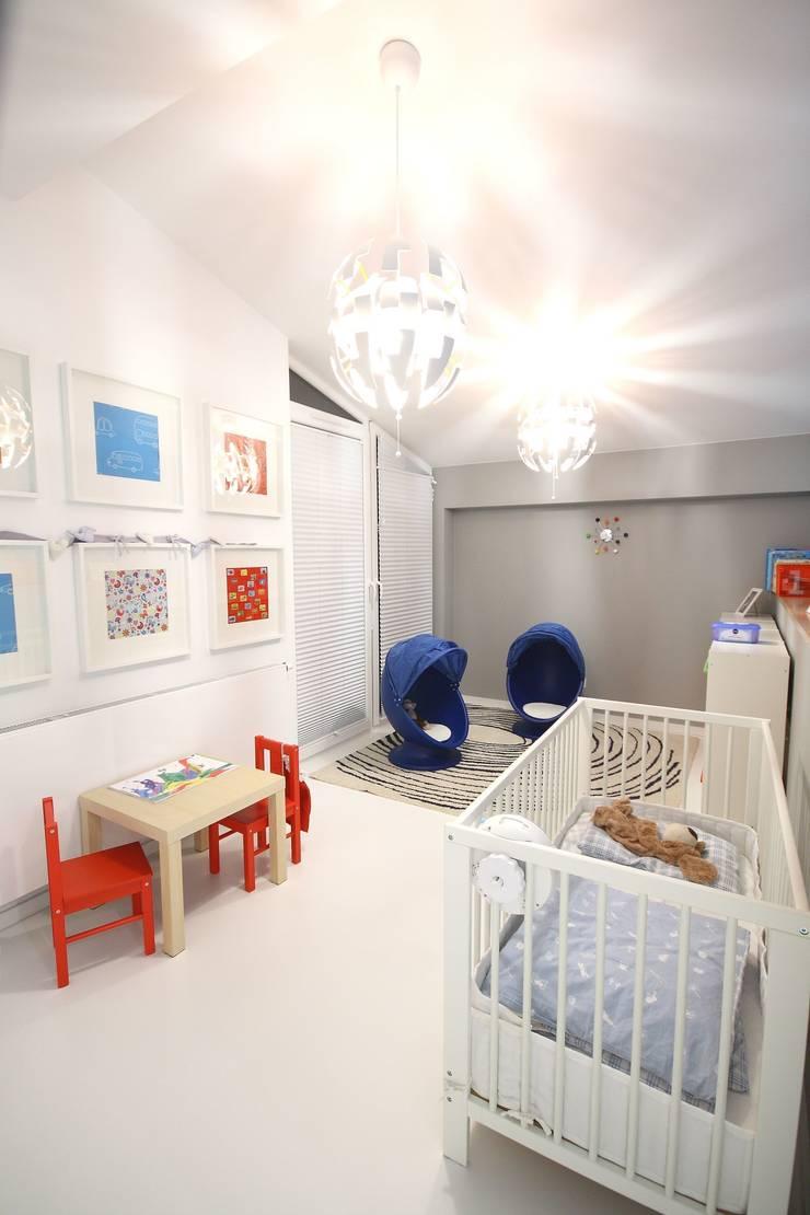 Pokój chłopca- realizacja: styl , w kategorii Pokój dziecięcy zaprojektowany przez Orange Studio