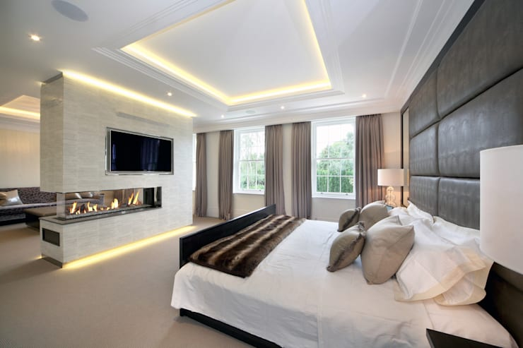 Master bedroom with suspended fireplace:  Bedroom by Hale Brown Architects Ltd