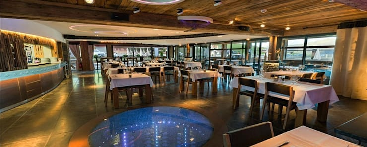 Salle de restaurant: Restaurants de style  par JFC Mermillod