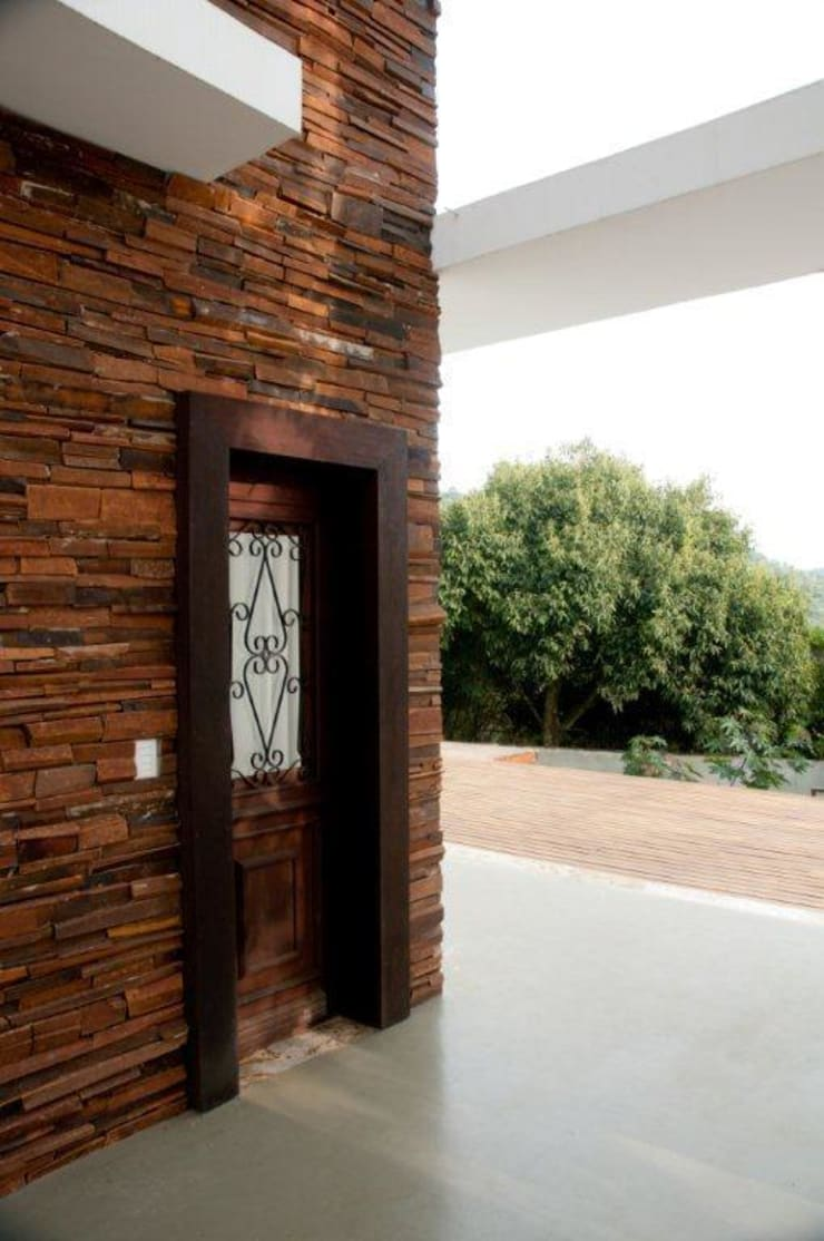 Projeto arquitetônico para residencia unifamiliar. (Fotos: Lio Simas): Casas  por ArchDesign STUDIO