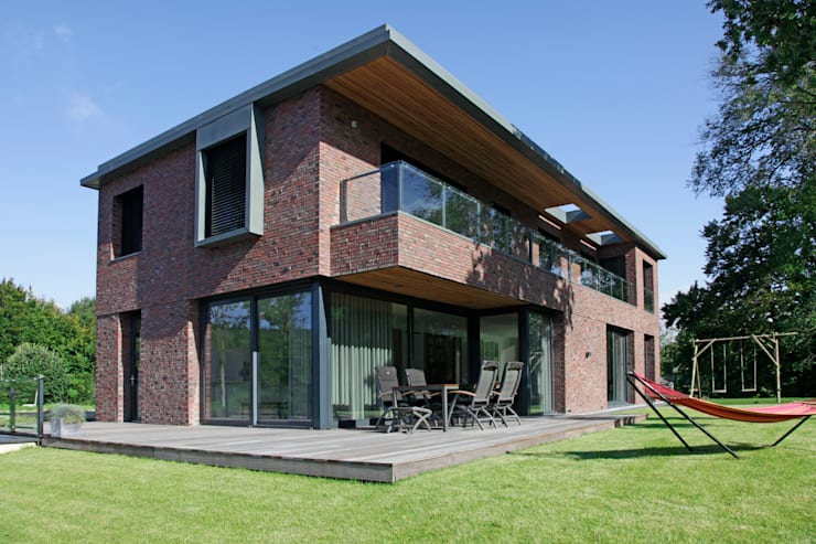 Casas de estilo  por Archstudio Architecten | Villa's en interieur