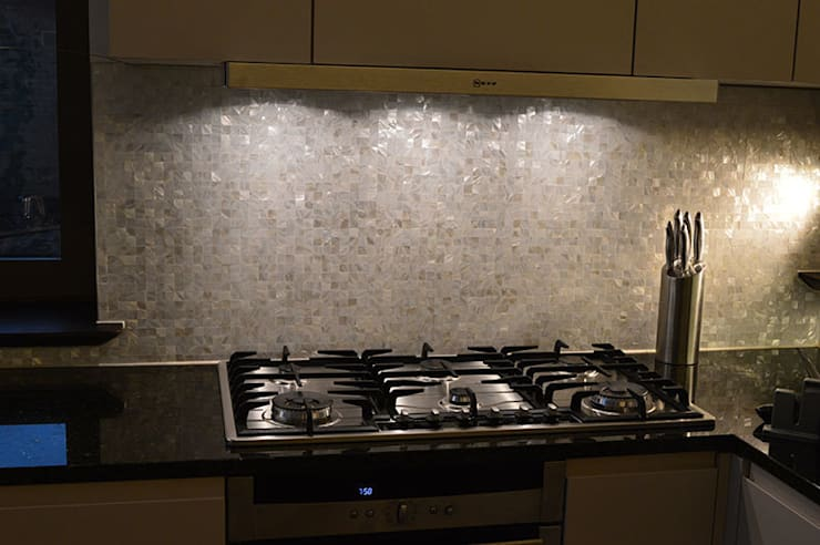 Seamless freshwater pure white mother of pearl used in the bathroom and kitchen of architect Timothy Crum's home.:  Kitchen by ShellShock Designs