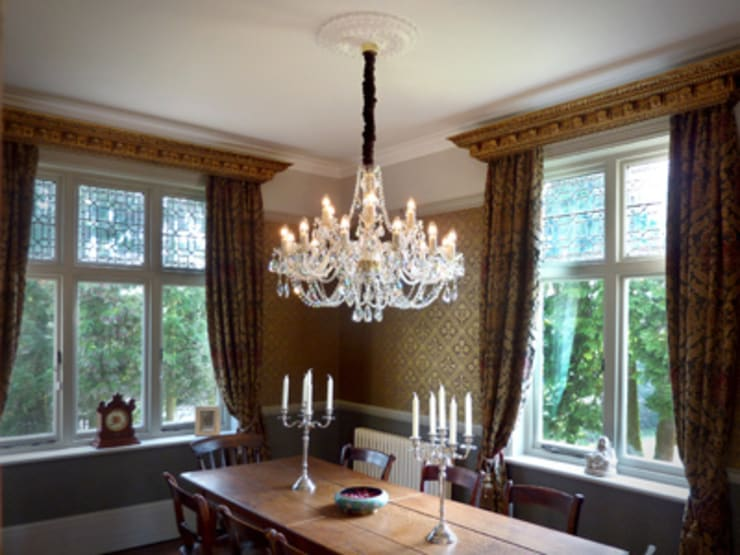 Victorian dining room with dual aspect:  Dining room by The Victorian Emporium