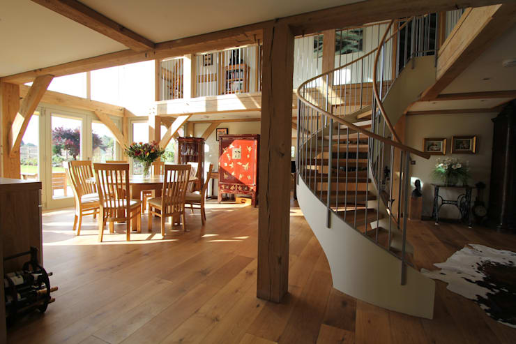 The kitchen/breakfast room and spiral stair:  Living room by Hale Brown Architects Ltd