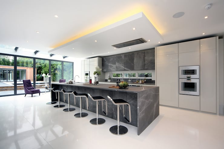 The new kitchen/breakfast bar with dark marble worktops and cabinet doors:  Kitchen by Hale Brown Architects Ltd