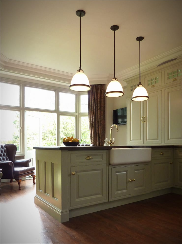 Kitchen renovation showing island, lights, cupboards and bay window:  Kitchen by The Victorian Emporium