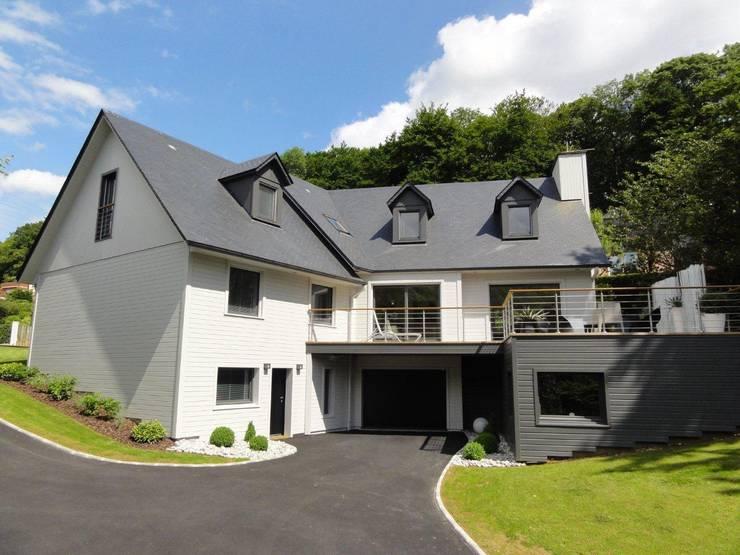 maison ossature bois: Maison de style  par C-tempo SAS
