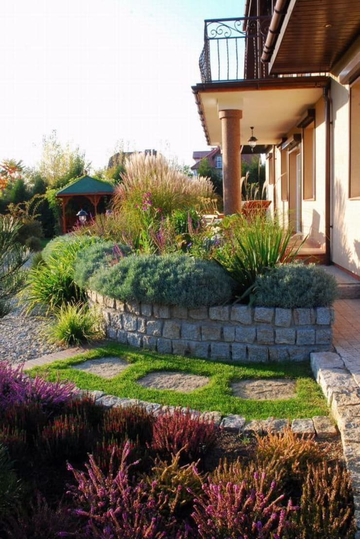 Słoneczny taras: styl , w kategorii  zaprojektowany przez Garden Idea - Projektowanie Ogrodów,Klasyczny