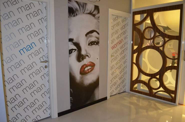 Emre Urasoğlu İç Mimarlık Tasarım Ltd.Şti. – Bomak Hobby Center - Adana: modern tarz Pencere & Kapılar