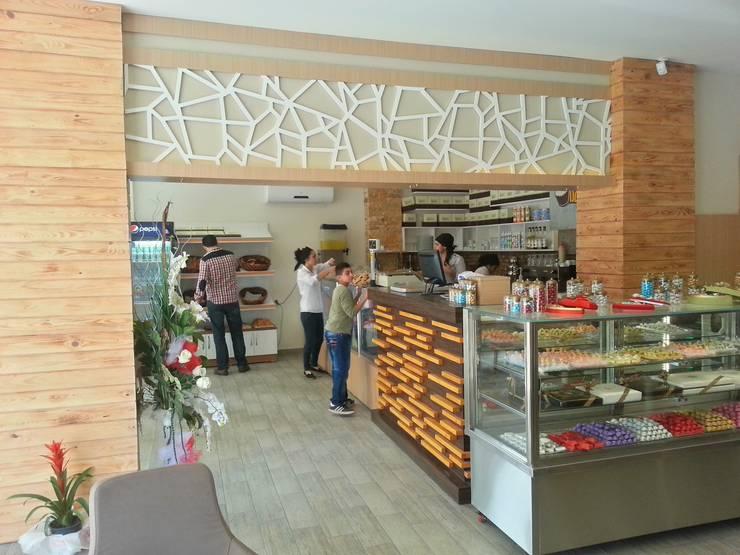 Interior landscaping by Emre Urasoğlu İç Mimarlık Tasarım Ltd.Şti.