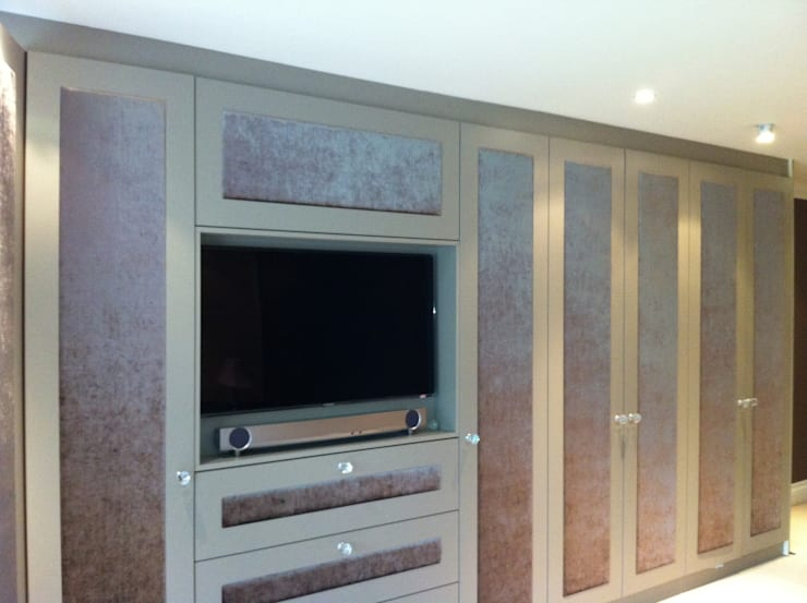 wardrobes with inset TV.:  Bedroom by Designer Vision and Sound: Bespoke Cabinet Making