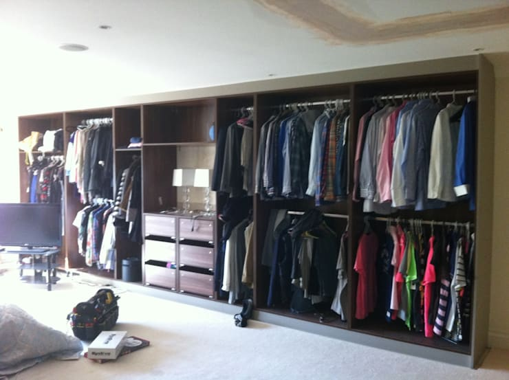 multiple his and hers storage areas.:  Bedroom by Designer Vision and Sound: Bespoke Cabinet Making