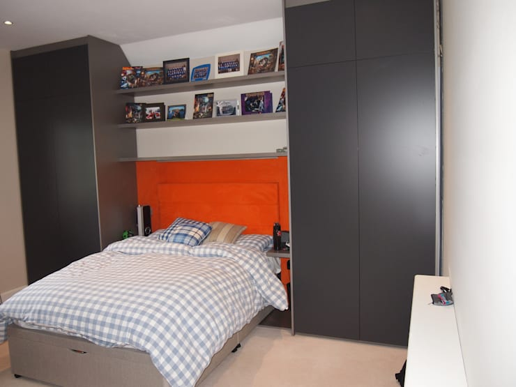 large full height wardrobes, floating shelves, orange suede headboard with LED lighting with side tables.:  Bedroom by Designer Vision and Sound: Bespoke Cabinet Making
