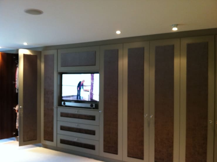 Hand sprayed doors with suede inlayed panels:  Bedroom by Designer Vision and Sound: Bespoke Cabinet Making