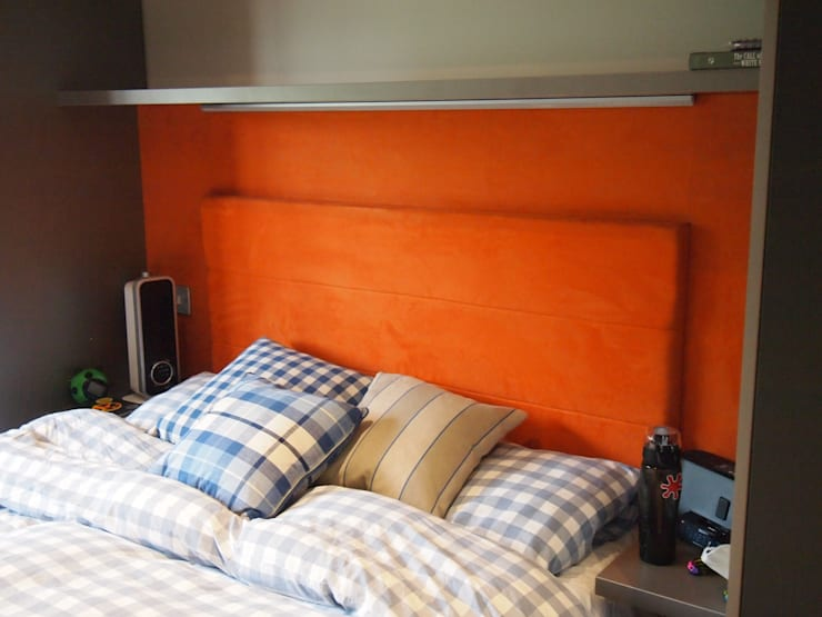 stylish bright orange suede headboard with LED lighting.:  Bedroom by Designer Vision and Sound: Bespoke Cabinet Making