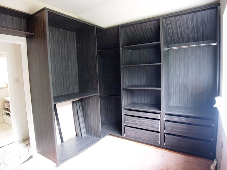walk in his and her's wardrobes. before and after photos.:  Dressing room by Designer Vision and Sound: Bespoke Cabinet Making