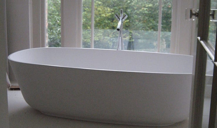 The refurbished bathroom with free-standing bath:  Bathroom by Hale Brown Architects Ltd