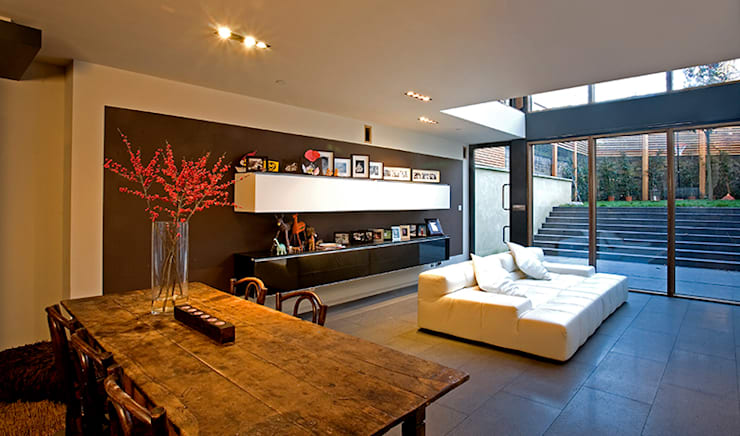 The new living room with a void to the :  Living room by Hale Brown Architects Ltd