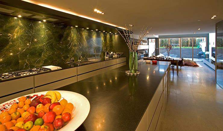 The minimal kitchen area:  Kitchen by Hale Brown Architects Ltd