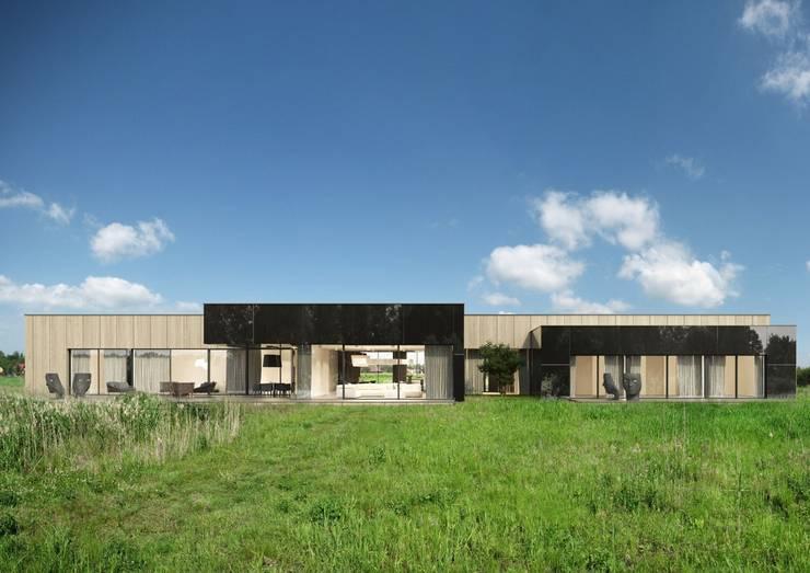 Dom w Dobroniu: styl nowoczesne, w kategorii Domy zaprojektowany przez REFORM Architekt Marcin Tomaszewski