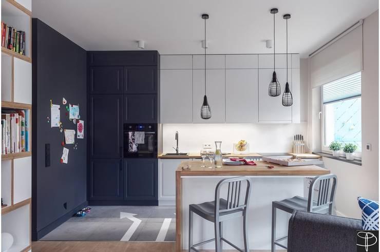 Wnętrze z Banksym: styl , w kategorii Kuchnia zaprojektowany przez Studio Potorska