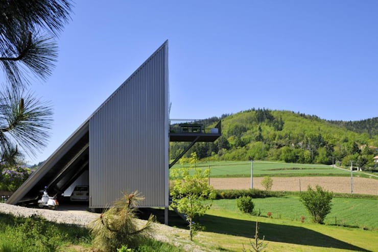 Maison triangle: Maisons de style  par barres-coquet architectes