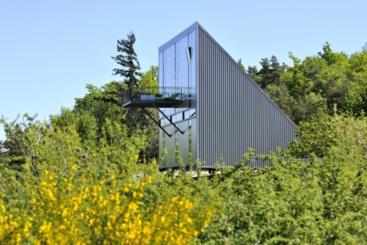 Maison triangle: Maisons de style de style Industriel par barres-coquet architectes