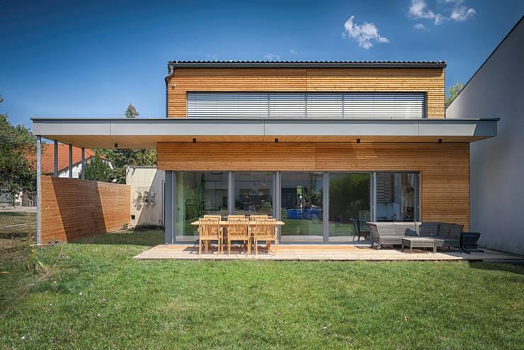 Casas de estilo  por AL ARCHITEKT -  in Wien