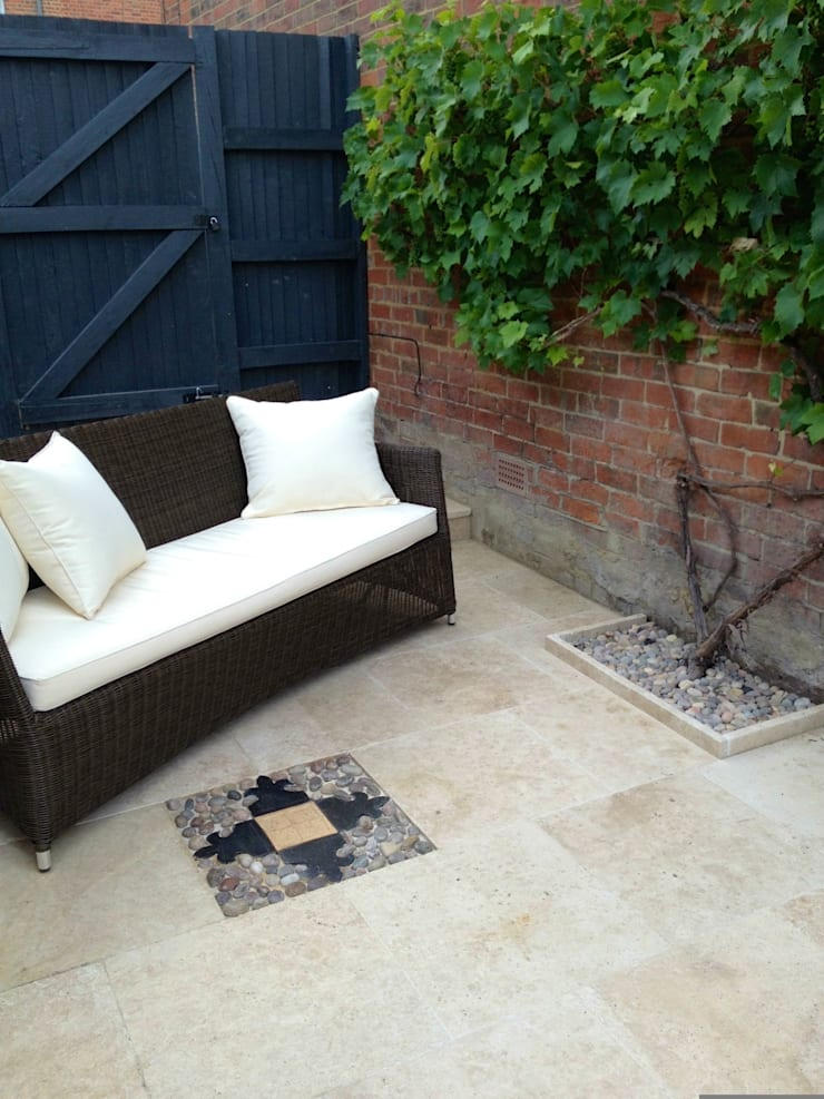 Paving detail & sofa :  Garden  by Amy Perkins Garden Design Ltd