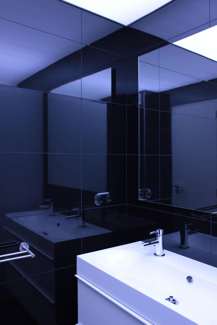 salle de bain: Salle de bains de style  par cambiums