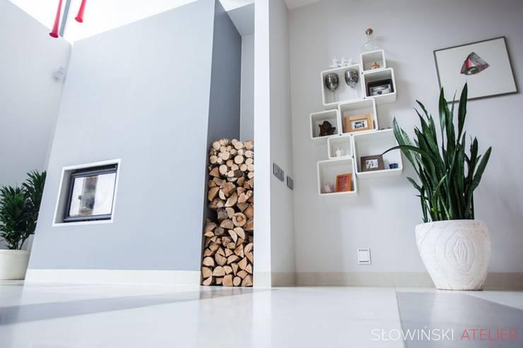 Kominek: styl , w kategorii Salon zaprojektowany przez Atelier Słowiński