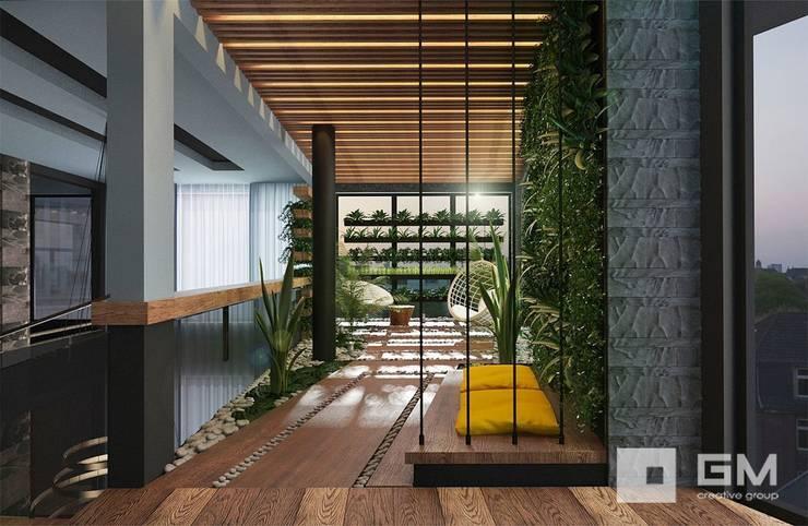 Jardines de invierno de estilo  de GM-interior