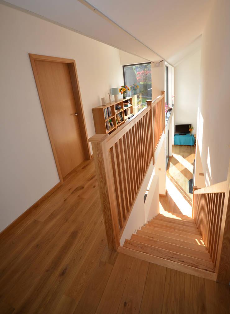 Maryville Passive House:  Corridor & hallway by Joseph Thurrott Architects