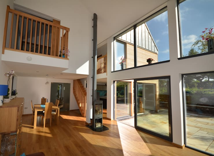Maryville Passive House:  Living room by Joseph Thurrott Architects