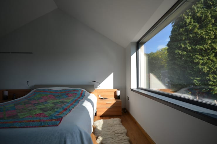 Maryville Passive House:  Bedroom by Joseph Thurrott Architects