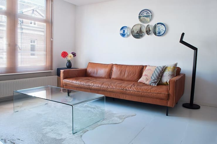 Salones de estilo moderno de IJzersterk interieurontwerp Moderno