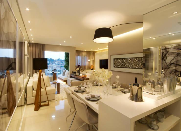 MAC_Otacílio: Salas de jantar  por Chris Silveira & Arquitetos Associados