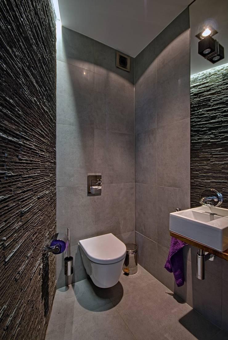 Dom w Overijse, Belgia: styl , w kategorii Łazienka zaprojektowany przez SHOQ STUDIO Architektura i wnętrza