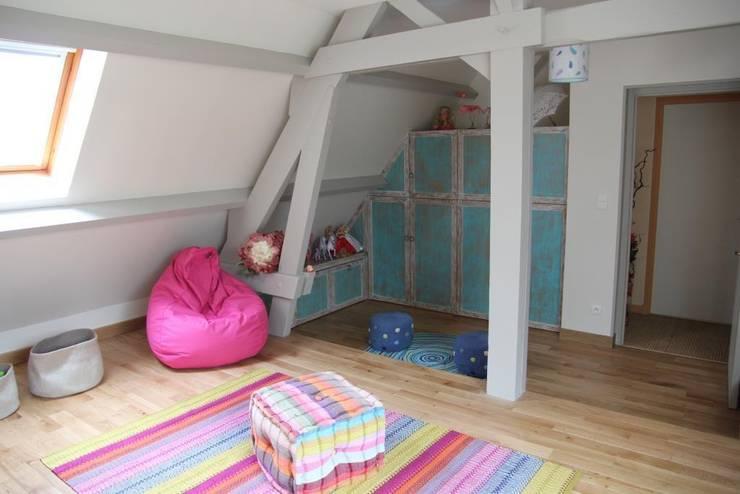 Espaces de rangement: Chambre d'enfants de style  par Noémie Vernet