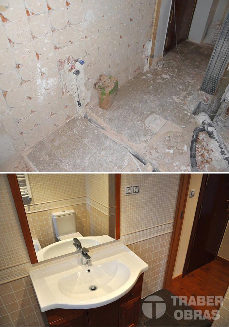 Reforma integral de vivienda por Traber Obras . Cuarto de baño antes y después.:  de estilo  de Traber Obras
