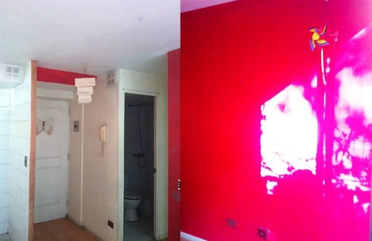 Pared roja en el salón antes de la reforma:  de estilo  de Estar Design