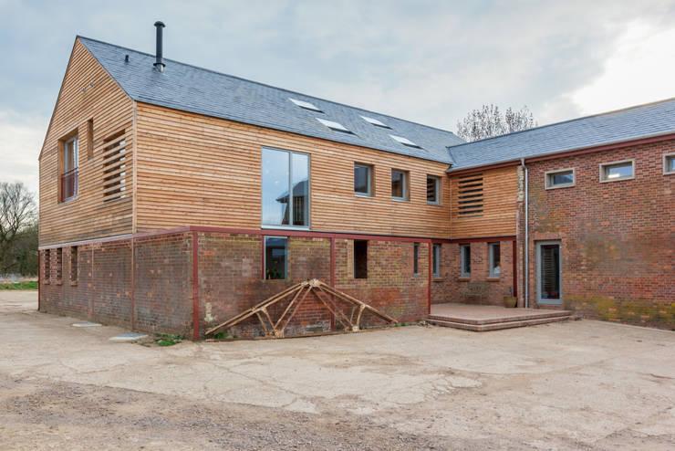 Farm yard:  Houses by Whitaker Studio