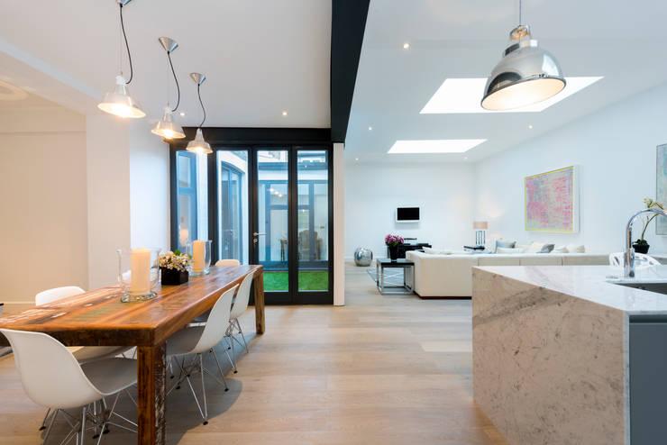 Roland Gardens : minimalistic Dining room by BTL Property LTD