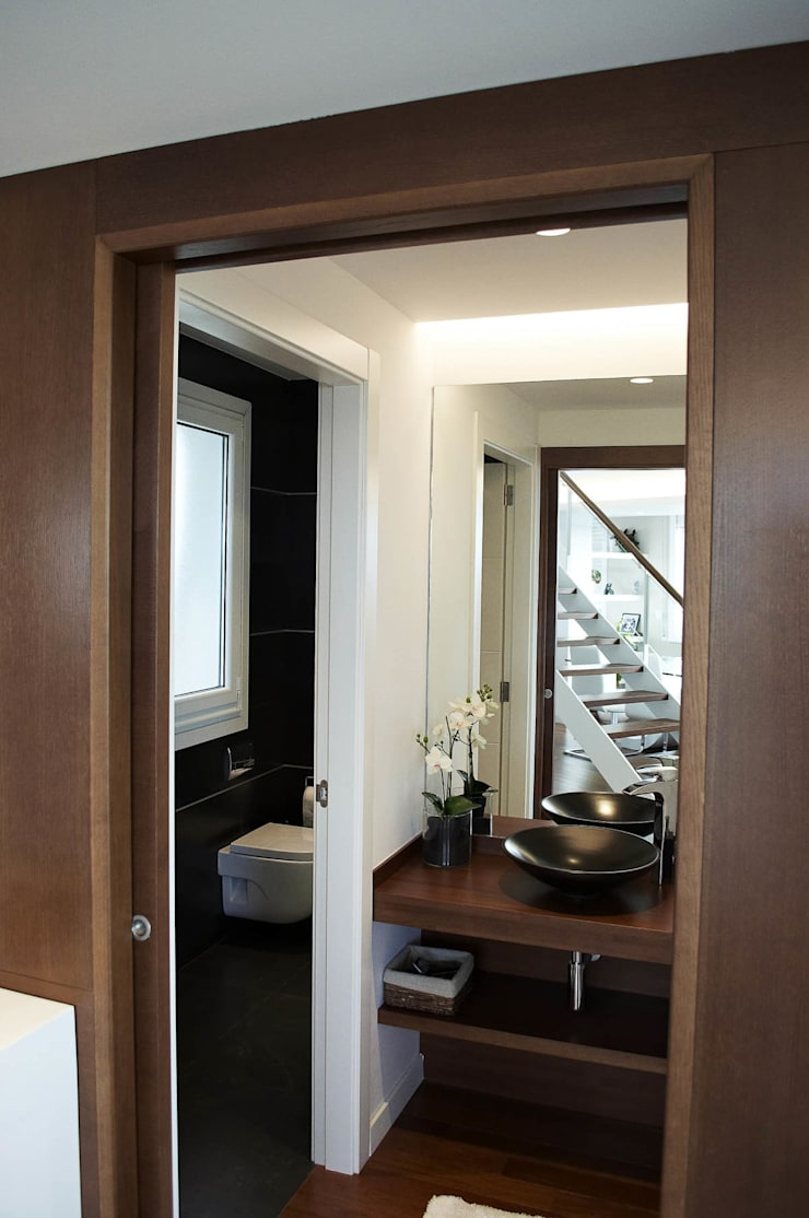 Reforma integral de piso: Baños de estilo  de Intra Arquitectos