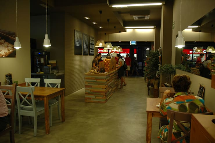 Panaria Panaderias: Locales gastronómicos de estilo  de Alicia Toledo