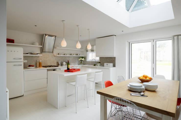 Bright, light Kitchen extension with roof lantern:  Kitchen by ZazuDesigns
