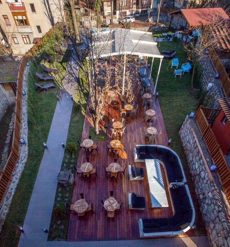 BOYTORUN ARCHITECTS – BARTIN KAF KONAK - BAHÇE:  tarz Oteller