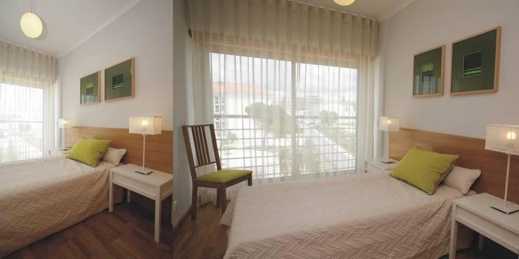 Quarto de visitas: Quartos  por Traço Magenta - Design de Interiores