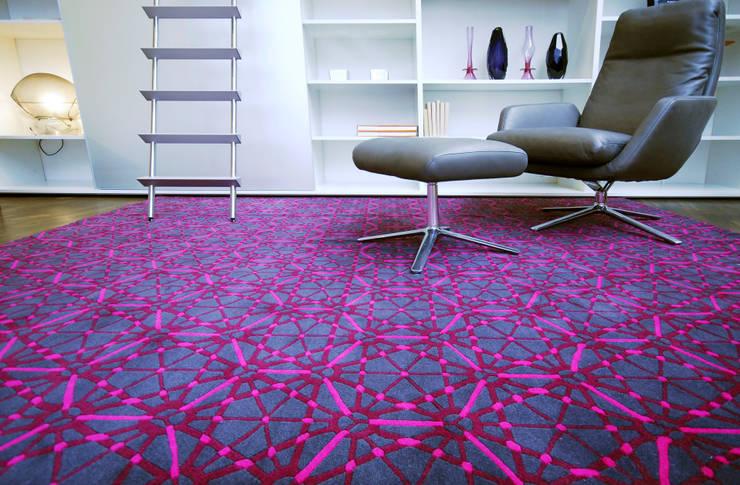 Paredes y suelos de estilo moderno de Mischioff AG