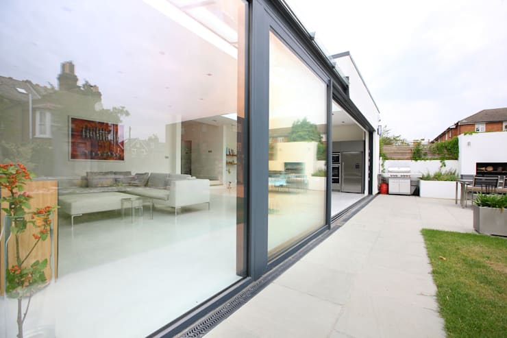 Glass sliding doors, :  Houses by PAD ARCHITECTS
